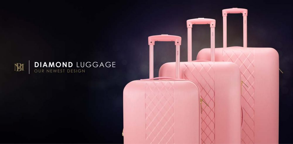 three pink suitcases